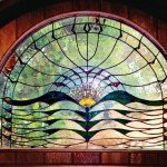 Sun Hawk House, stained glass door installation - Built by Michelle Copeland at ThistleGlass.com