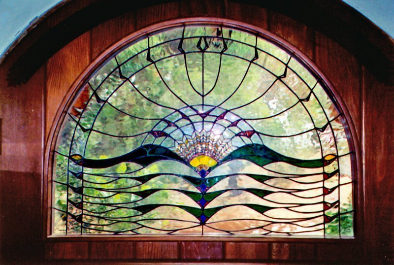 Sun Hawk House, stained glass door installation - Built by Artist Michelle Copeland